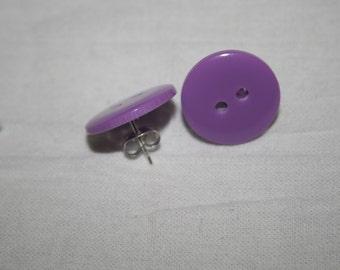 Plain purple button earrings.