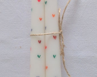 Hand-painted taper candles with multi-coloured hearts set of two
