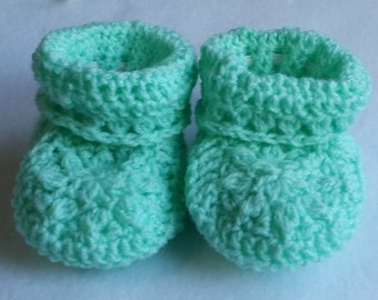 Green hand crocheted baby booties