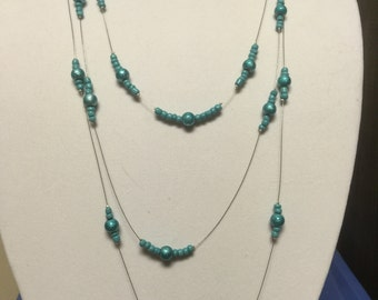 Three-strand necklace in teal