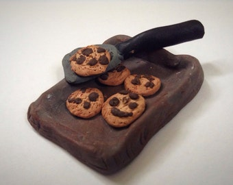 Chocolate cookies with a spatula and a pan