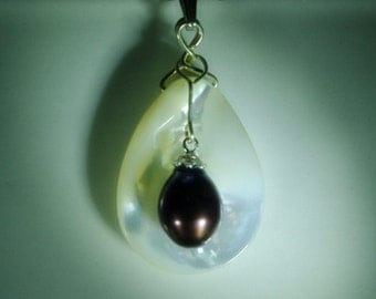 Fresh water pearl with mother of pearl sterling silver pendant