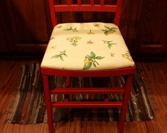 Reupholstered/painted folding chair.