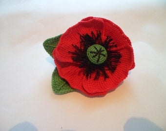 A poppy flower hair clip