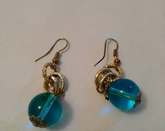 earrings with blue water