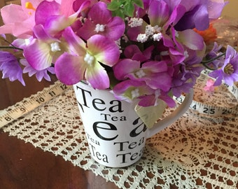Tea cup decorated by hand with flowers 1003