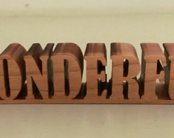 Inspirational word made from cherrywood. Free standing