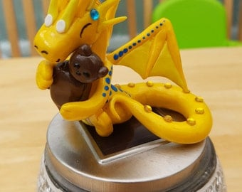 A hand crafted polymer clay dragon hugging her little beast. Inspired by my favourite Disney movie beauty and the beast.