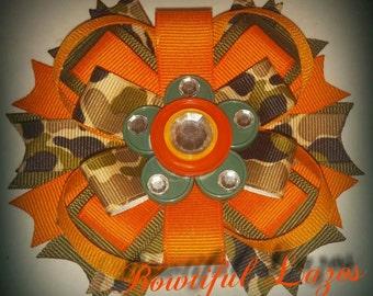 Orange camo pinwheel hair bow