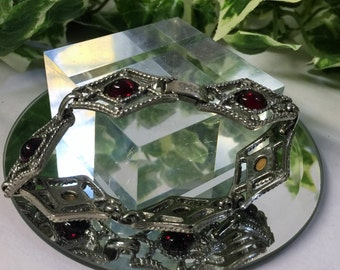 A Lovely Vintage Silver Tone and Red Glass Stone Bracelet