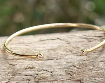 gold-plated ring 750 thousandth 3 microns and cz bracelet