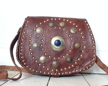 Hippie bohemian Moroccan leather bag with coins and central stone