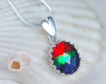 Gorgeous grade AA faceted ammolite framed in Argentium* sterling silver pendant..
