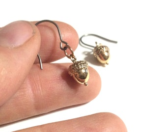 Delicate brass acorn earrings on hypoallergenic titanium earwires