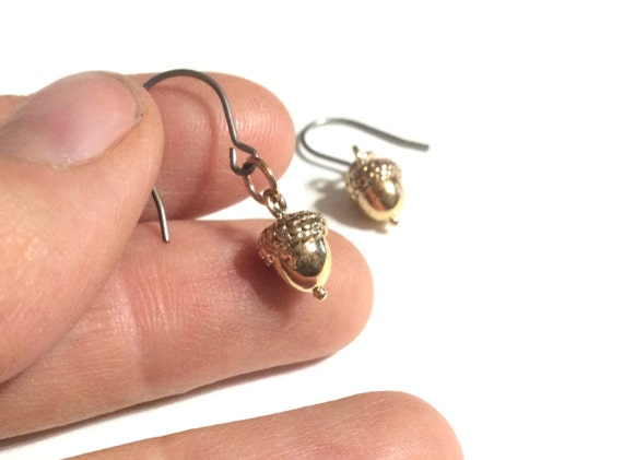 Delicate brass acorn earrings on hypoallergenic titanium earwires