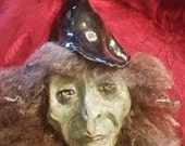 Creepy hand sculpted witch