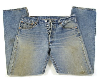 """Levi's 501 XX Jeans / Vintage Distressed High Waist Button Fly Medium Wash Denim / Worn In Thrashed Frayed Holes Faded / Unisex 32"""" x 32.25"""""""