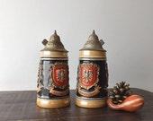 2 Vintage German Stoneware Lidded Beer Steins, Reinhold Merkelbach, Frankfurt Wiesbaden Heidelberg Crests