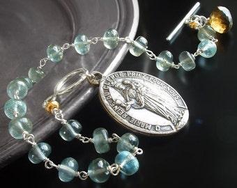 ON SALE  25% OFF Moss Aquamarine Rosary Charm Bracelet with Vintage Medallion, Topaz, and Sterling Silver