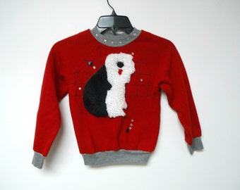 black and white hairy dog . applique sweater . girls size 4 . made in USA