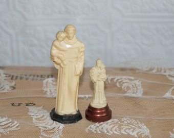 Two vintage plastic Saint Anthony statues