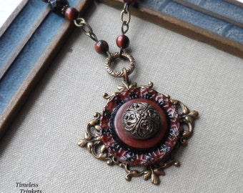 Sweetbriar, Vintage Celluloid Button with Victorian Button Necklace- Onyx and Red Tigers Eye Beads