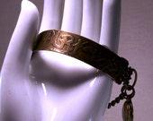 Brass Statement Bangle Bracelet With Cross Charm and Vintage Working Locket Original Assemblage Design OOAK Asian Oriental Inspired