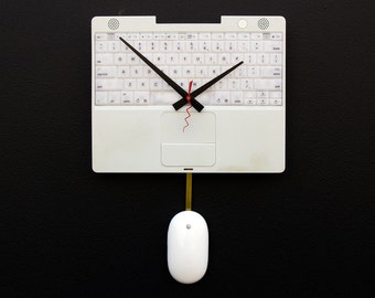 Clock created from a recycled Apple ibook laptop keyboard and cover