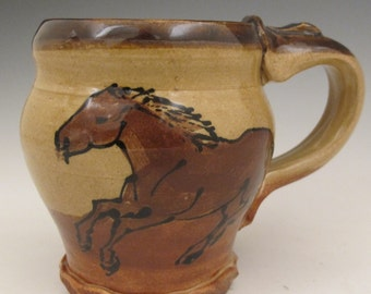 Mug with horses slip trailed  pottery