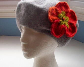Beret, wool, embellished with large flower pin corsage hand knit shades of orange red