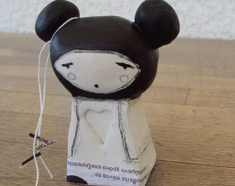 girl with black dyed hair clay doll