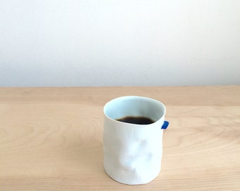 porcelain crumple coffee cup