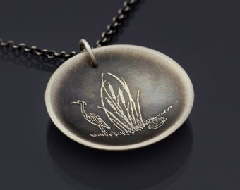 Great Blue Heron and Muskrat Among the Cattails -  etched sterling silver necklace