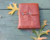Soft brown leather journal with skeleton key
