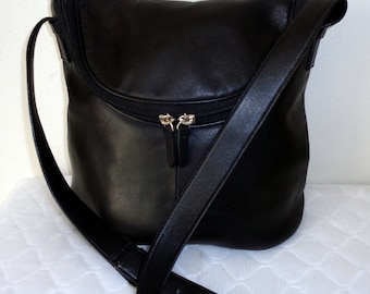 All genuine leather cross body  bag, messenger bag , purse, satchel, saddle bag in deep black awesome pistine condition vintage
