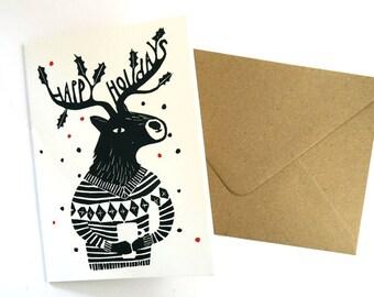 Christmas wenskaart - vakantie rendieren in zwart, wit en rood - reproductie van originele lino drukken - gedrukte Copyscape