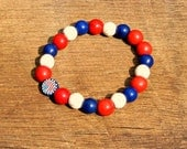 American Flag Bracelet helps provide service dogs to wounded military veterans soldiers USA United States America red white blue patriotic