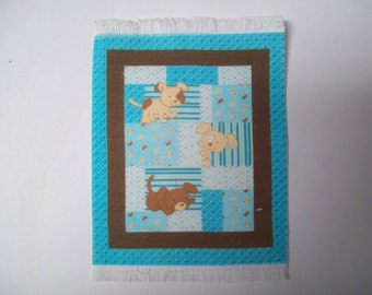 Miniature Printed Nursery Rug in aqua/brown with a dog theme. For the dollhouse