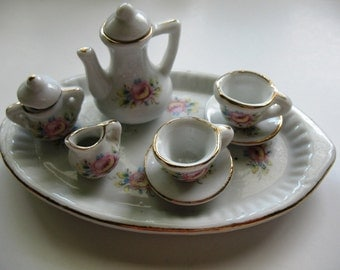 Miniature, Ceramic Tea Set in White with a Pink Floral Pattern.