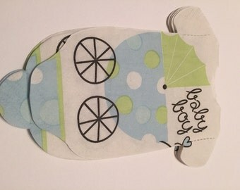 Baby shirt shaped paper napkins with adorable strollers.  Pink, blue, or green.