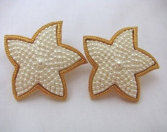 White textured Star shaped post back earrings with gold tone trim