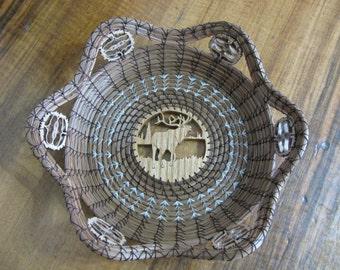 Scroll Sawn Image of an Elk Pine Needle Basket
