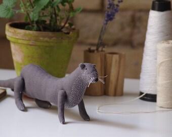Lutra lutra. Otter. Soft sculpture