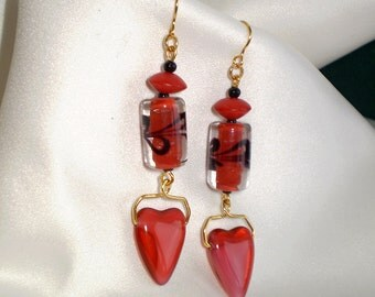 Red curve and barrel glass earrings with a black accent