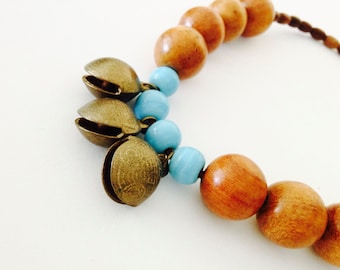 Chunky Tribal Ethnic Necklace with vintage Indian brass bells, lost wax casting, glass and wood beads