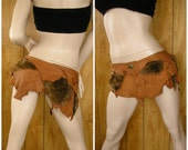 """Barbarian leather and faux fur in brown deerskin leather & brown and tan fur, buttons in the front, size 32"""" to 34"""""""