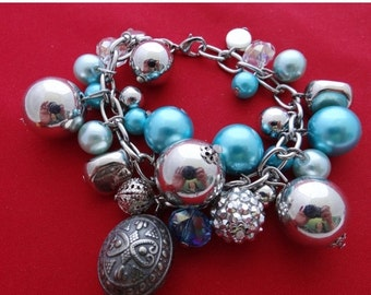 "20% off sale Vintage  silver tone 7"" bracelet loaded with silver and blue charms  in great condition"