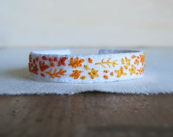Sunny Embroidered Fabric Cuff Bracelet - Hand Embroidered Bracelet in Oranges and Yellows and a bit of Red