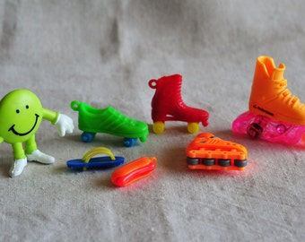 vintage lot rollerskate charms and toys