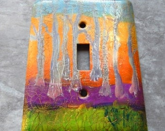 Winter Forest Sunset, abstract, mixed media, light switch cover, toggle switch plate, green, violet, orange, yellow, blue